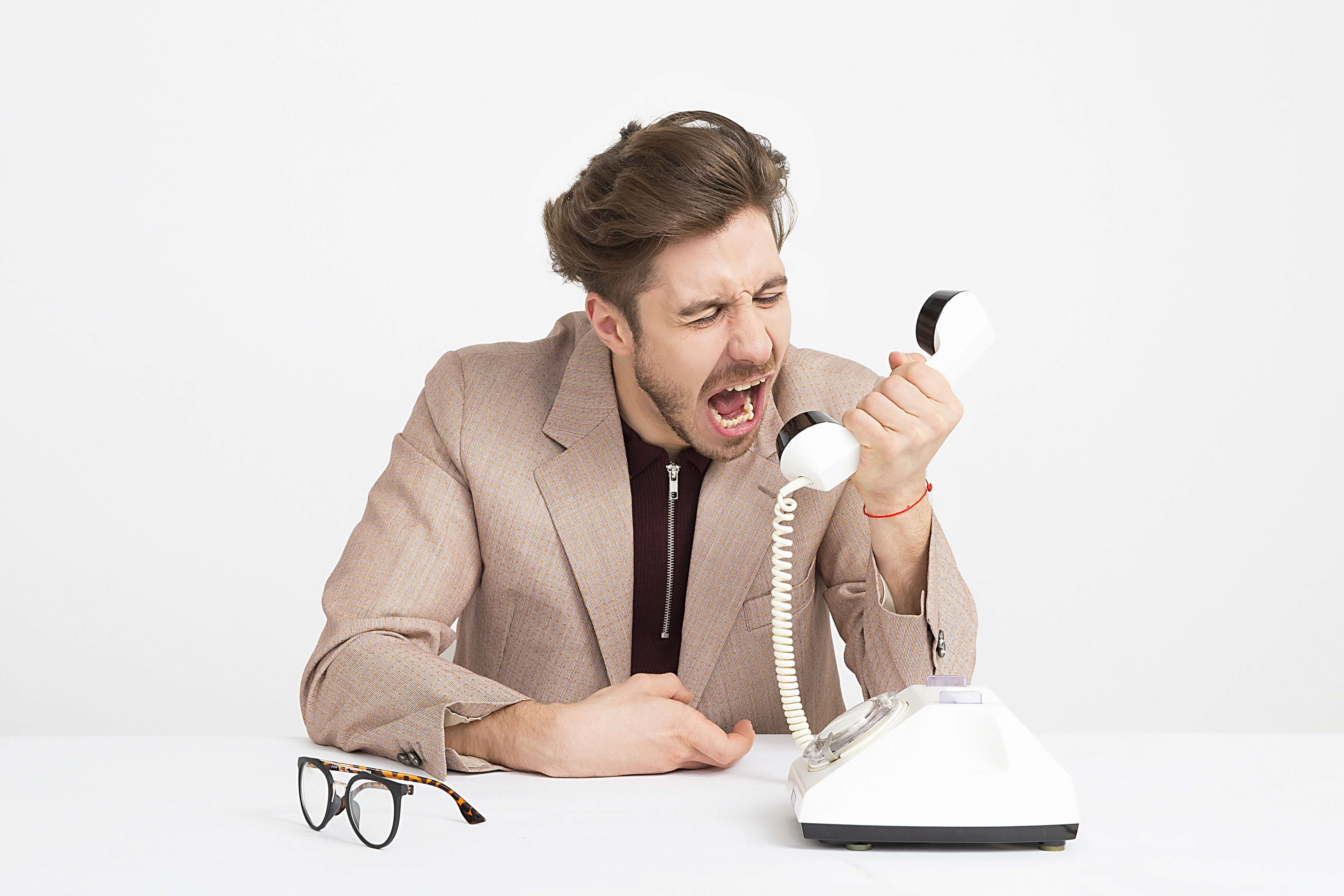 Man shouting on phone as he receives bad customer experience