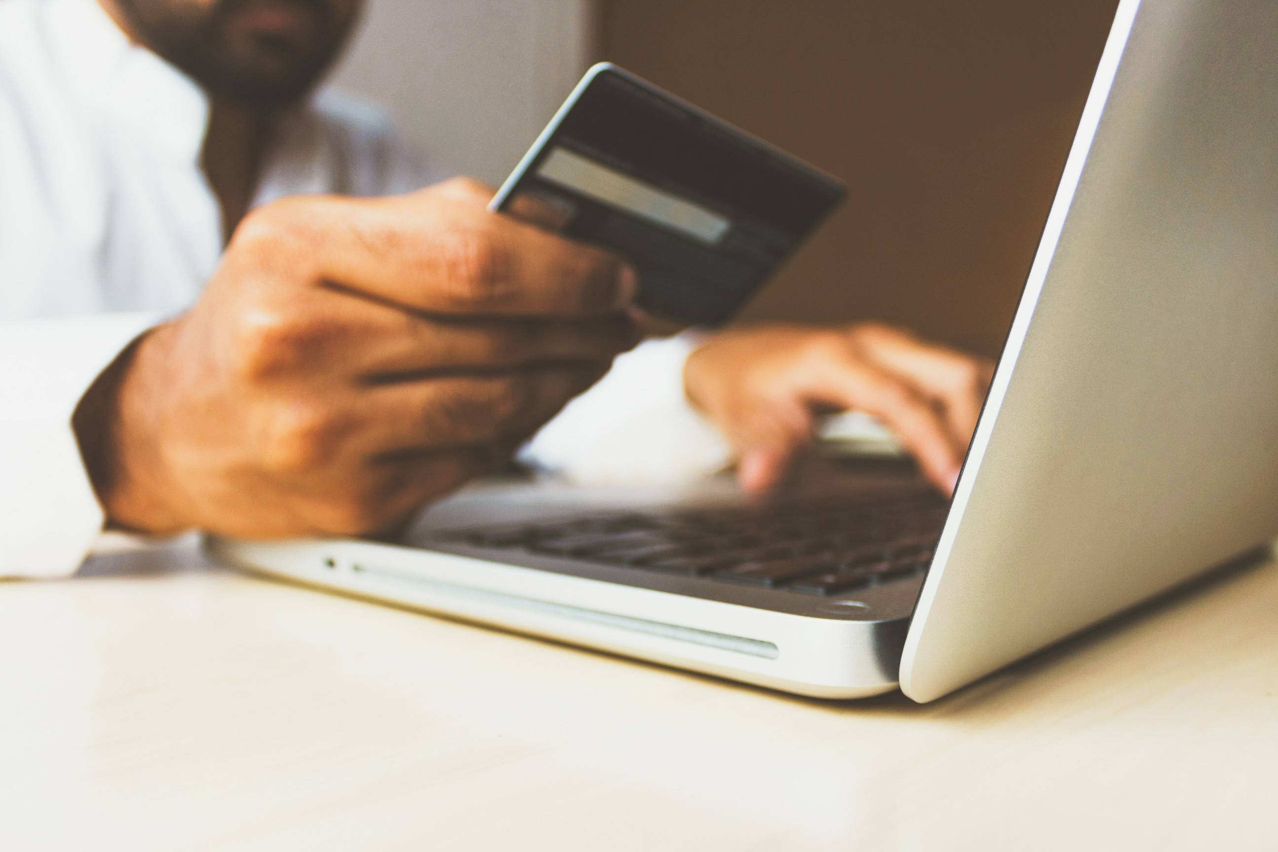 using a credit card and laptop to purch online - ecommerce customer experience