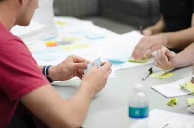 People mapping the customer journey using sticky notes
